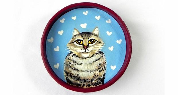 História legal: gatinhos viram quadros e produtos
