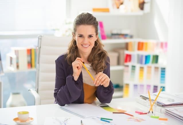 Portrait of smiling fashion designer in office